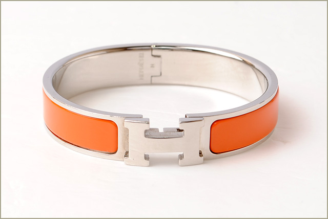 Hermes bangle / bracelet. HERMES click crack H bangle orange / silver