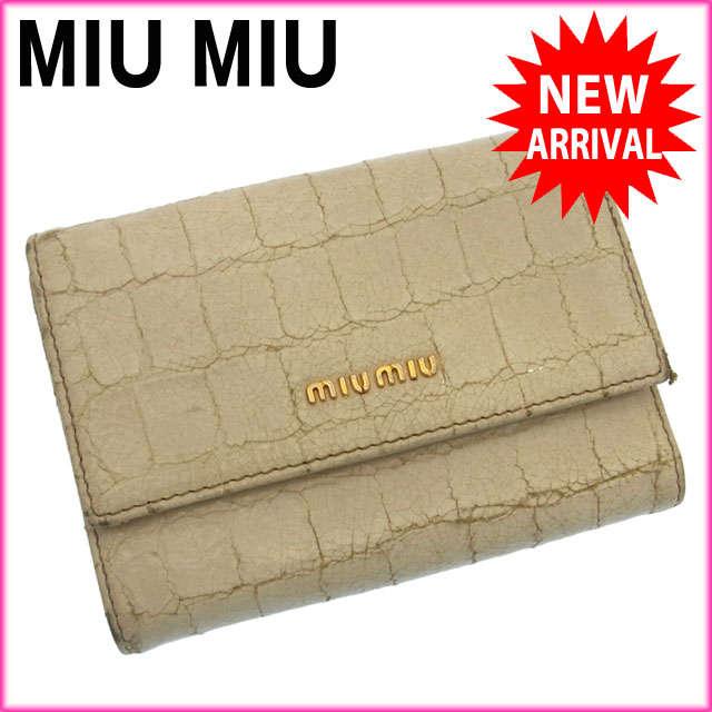 【中古】 【送料無料】 ミュウミュウ miumiu 三つ折り財布 コンパクトサイズ メンズ可 クロコ調型押し ロゴ ホワイト×ゴールド レザー F485