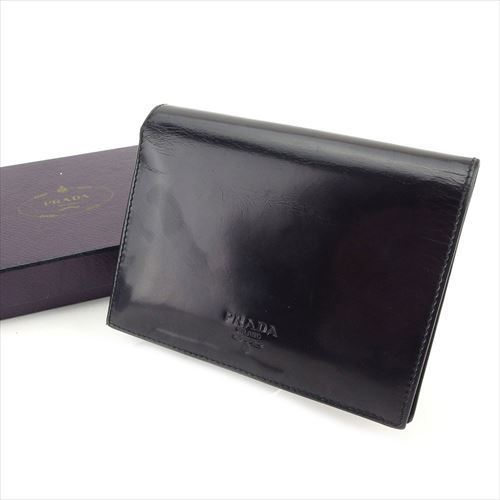 【中古】 【送料無料】 プラダ PRADA 二つ折り 財布 レディース メンズ 可 ロゴ ブラック レザー 人気 T5945 .