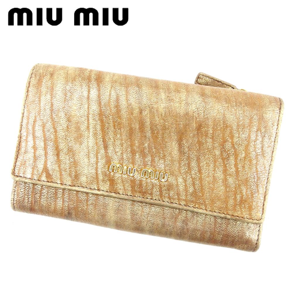 【中古】 ミュウミュウ miu miu 中長財布 三つ折り 財布 レディース  ゴールド レザー 人気 セール S671 .