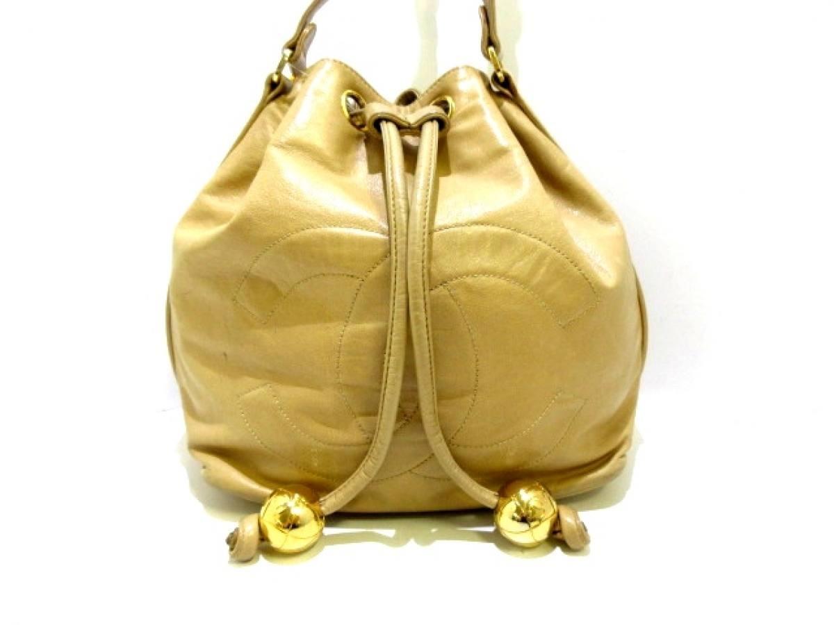 CHANEL(シャネル) ショルダーバッグ - ベージュ チェーンショルダー/ゴールド金具/巾着型 ラムスキン【中古】