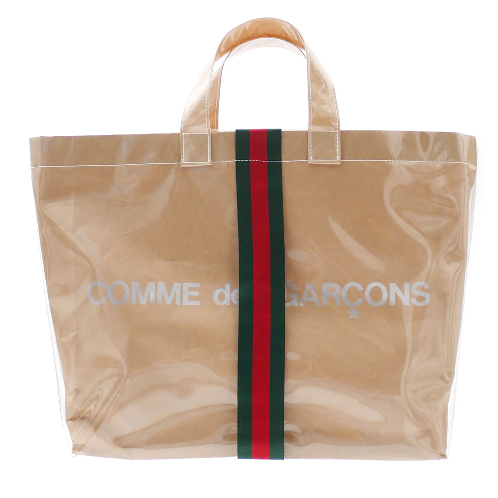 f5496d443a3b The premium Collaboration with GUCCI came true!!Based on very popular PVC  tote bag of COMME des GARCONS, Tape with GUCCI coloration is designed on  the ...