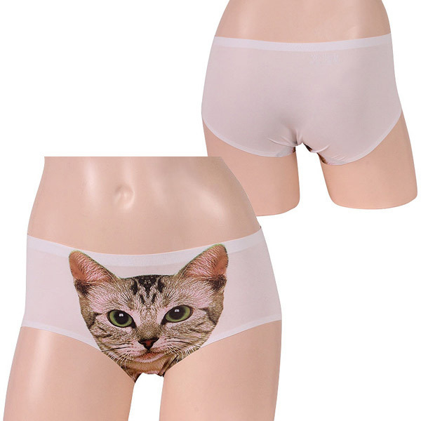 80dcc00aa73 White shorts with popular exploding cat print. The face of the cat  protrudes from between a crotch. ※This product may take three or four  business ...