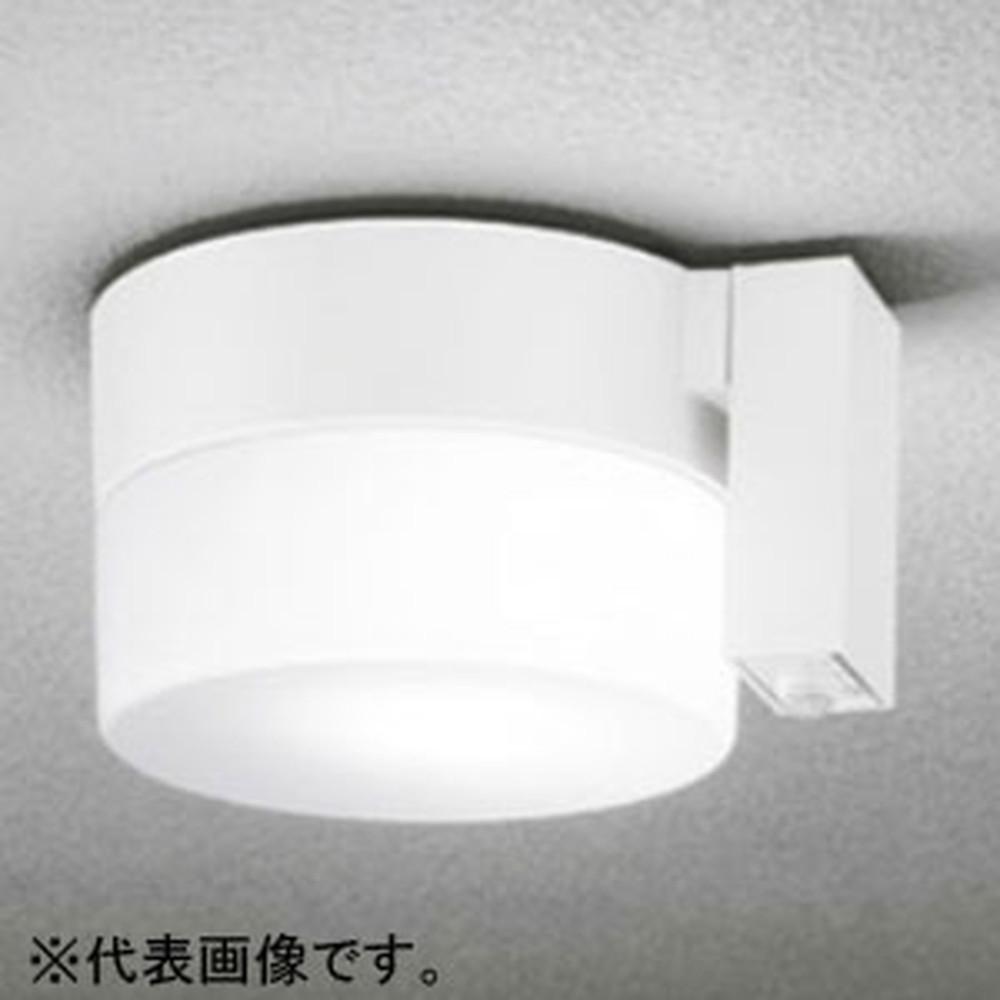 オーデリック LEDポーチライト 防雨型 軒下・天井面取付専用 白熱灯60W相当 電球色 人感センサ付 オフホワイト OG254401LC