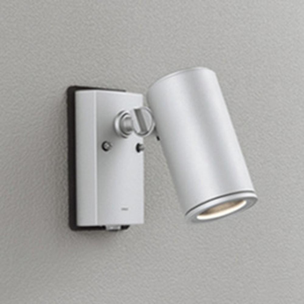 オーデリック LED一体型スポットライト COBタイプ 防雨型 JDR75W相当 電球色 ワイド配光 人感センサ付 マットシルバー OG254550P1