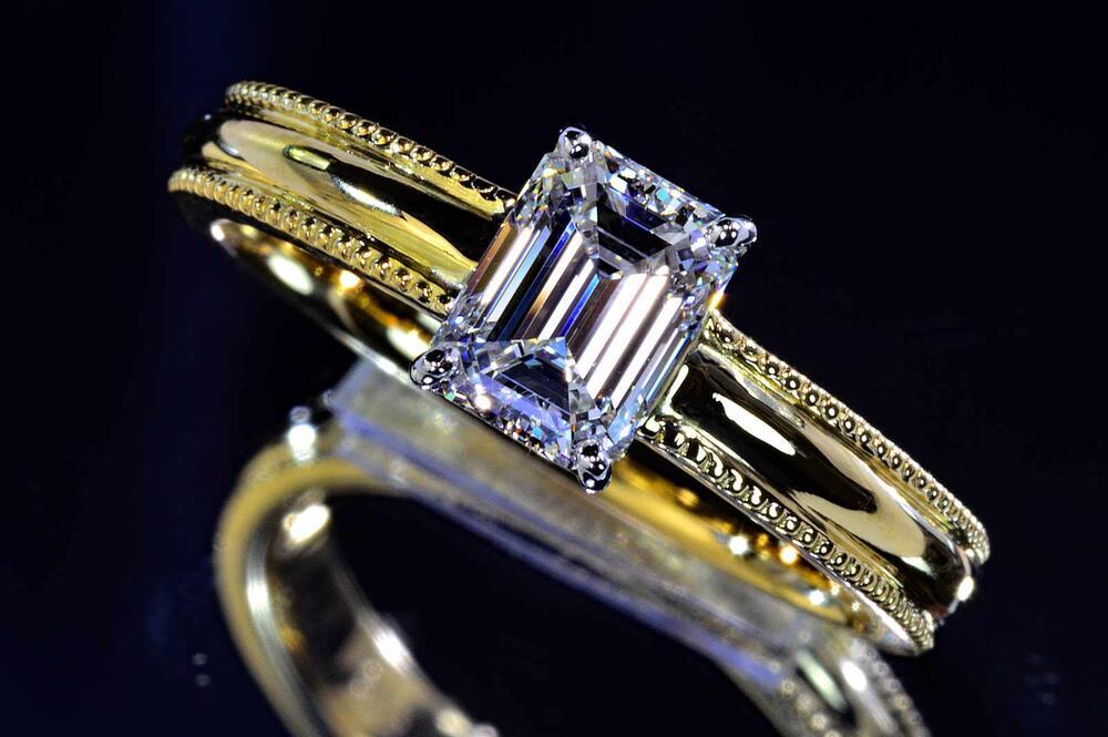 エメラルドカットダイヤモンドリング指輪プラチナとイエローゴールドのミルウチエメラルドカットダイヤアンティークダイヤモンドGIA鑑定書刻印つき