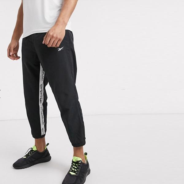 リーボック トレーニング ブラック テーピング ロゴ入り ジョガー 細身 ボトム パンツ 20代 30代 40代 ファッション コーディネート インポートブランド