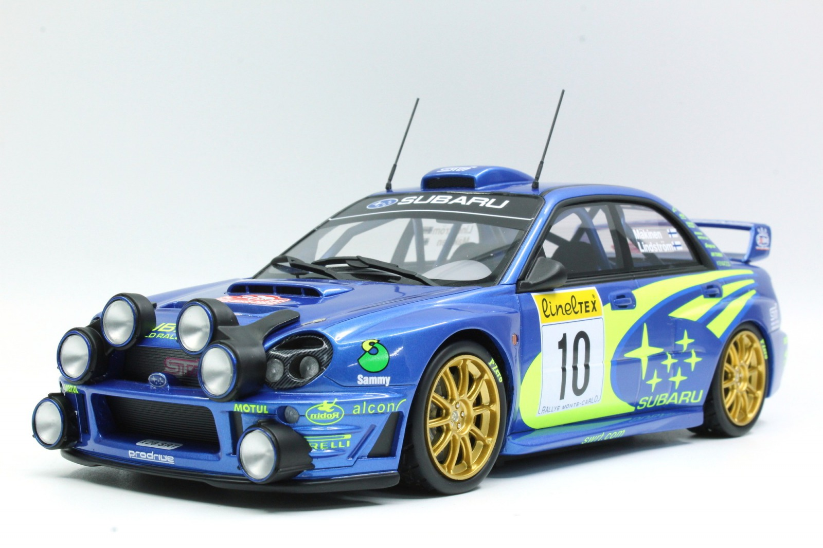 Topmarques トップマルケス 1:18 WRC 2002年ラリーモンテカルロ 優勝モデル スバル インプレッサ S7 555 WRT No.10SUBARU - IMPREZA S4 WRC (night and dirty version) N 10 WINNER RALLY MONTECARLO 2002 T.MAKINEN - K.LINDSTROM 1/18 by Topmarques NEW