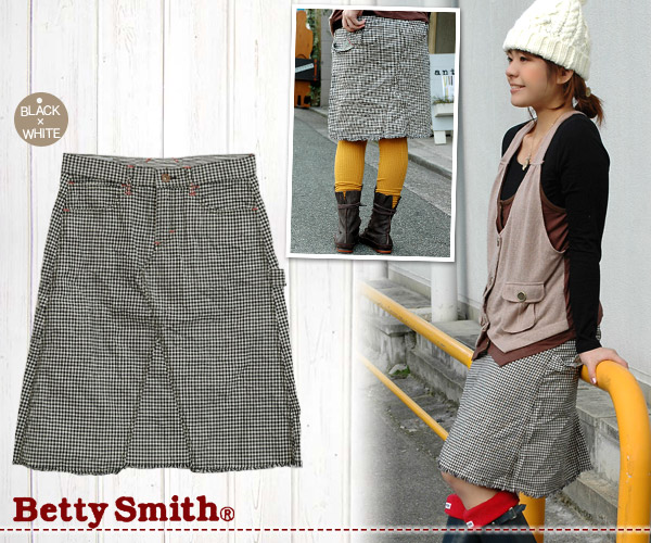 "A gingham check is sweetness in casual clothes. A painter skirt featuring moderate length comes up than popular jeans brand ""Betty Smith""! It is taking off the cap Betty ◆ Betty Smith in the discerning design including the stitch of the pink color and th"