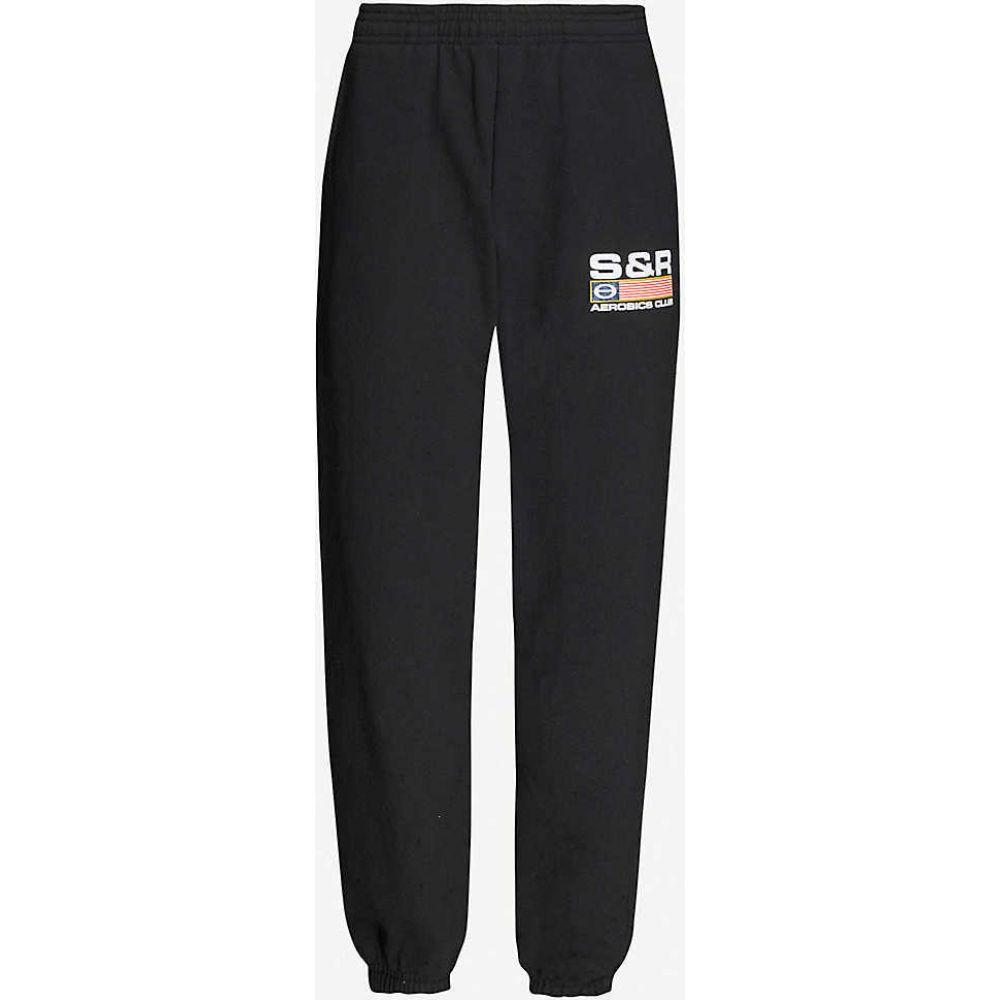 スポーティ アンド リッチ SPORTY & RICH レディース ボトムス・パンツ 【Flag-print branded cotton-jersey jogging bottoms】BLACK