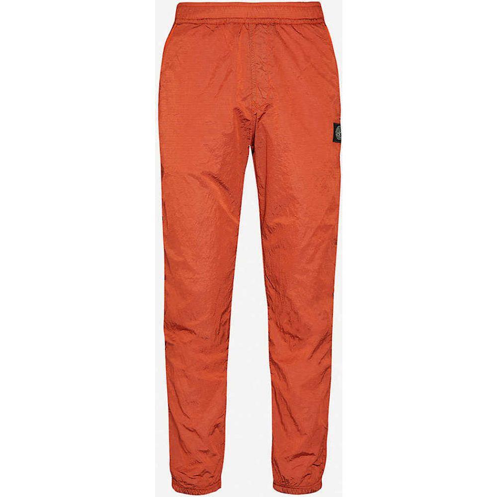 ストーンアイランド STONE ISLAND メンズ ボトムス・パンツ 【Woven-pattern tapered shell trousers】Orange Red