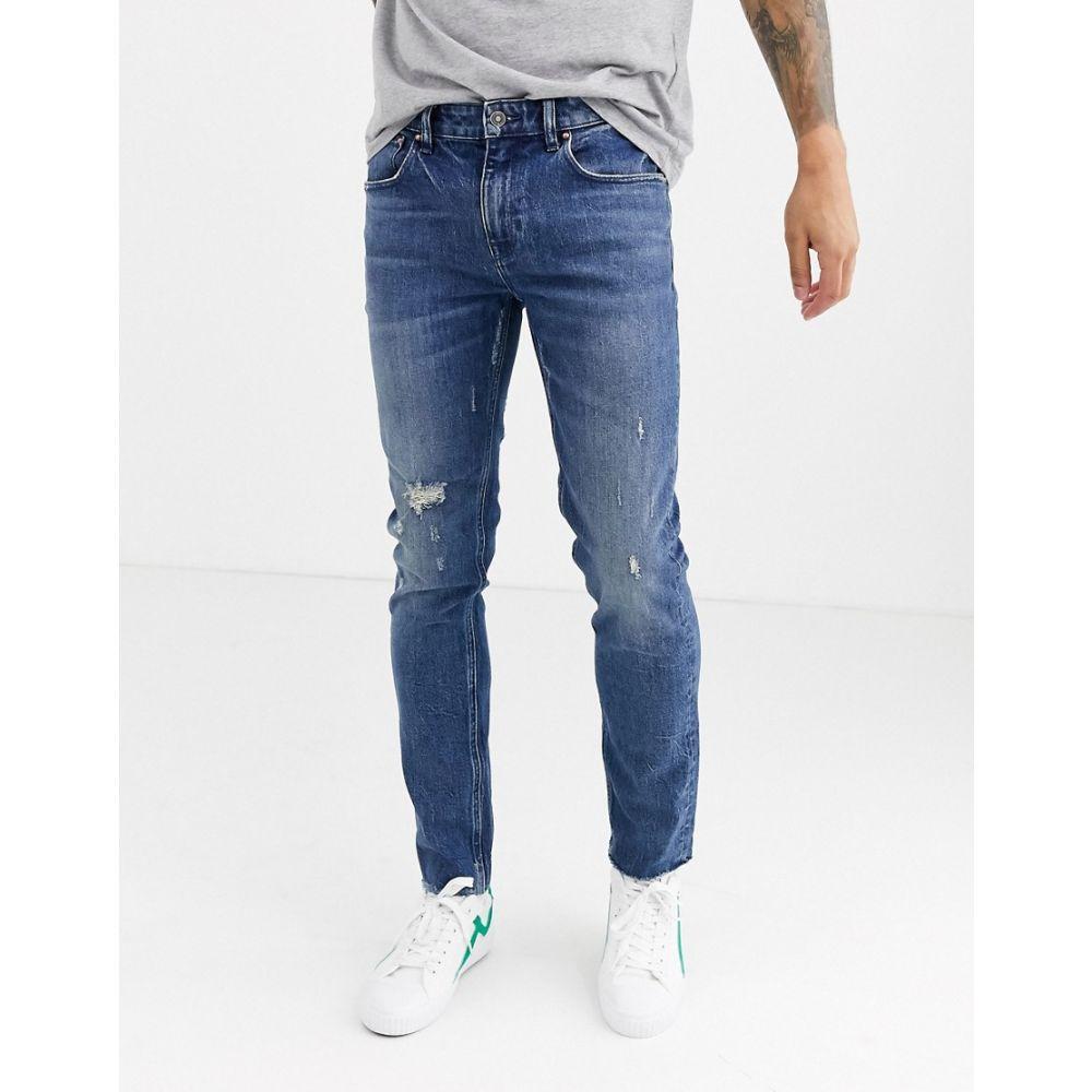 エイソス ASOS DESIGN メンズ ジーンズ・デニム ボトムス・パンツ【cone mill denim skinny 'american classic' jeans in mid wash blue with abrasions and raw hem】Mid wash blue