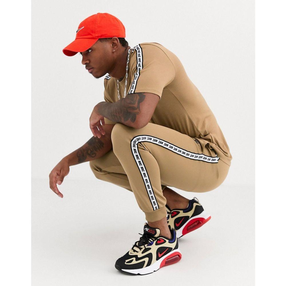 ナイキ Nike メンズ ジョガーパンツ ボトムス・パンツ【logo taping cuffed joggers in sand】Sand