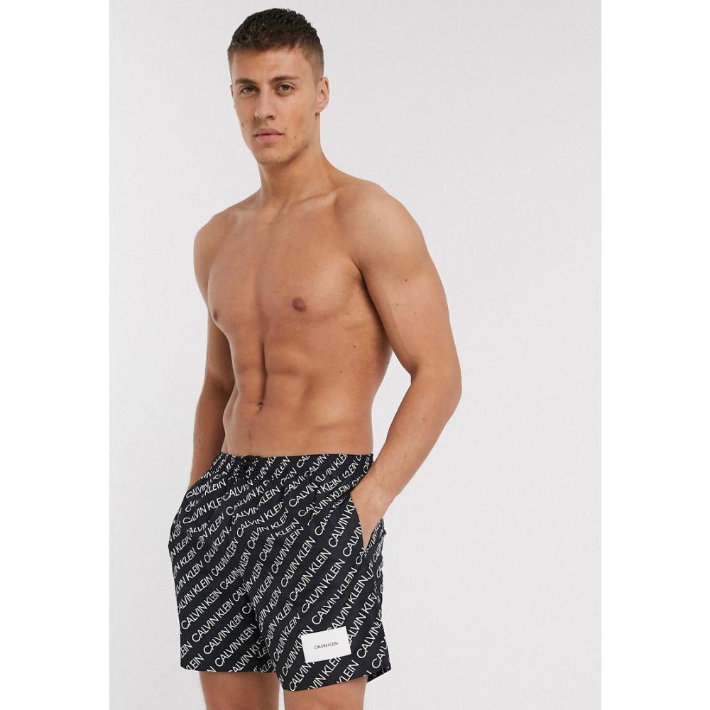 カルバンクライン Calvin Klein メンズ 海パン ショートパンツ 水着・ビーチウェア【all over logo crew recycled swim shorts in black co-ord】Black