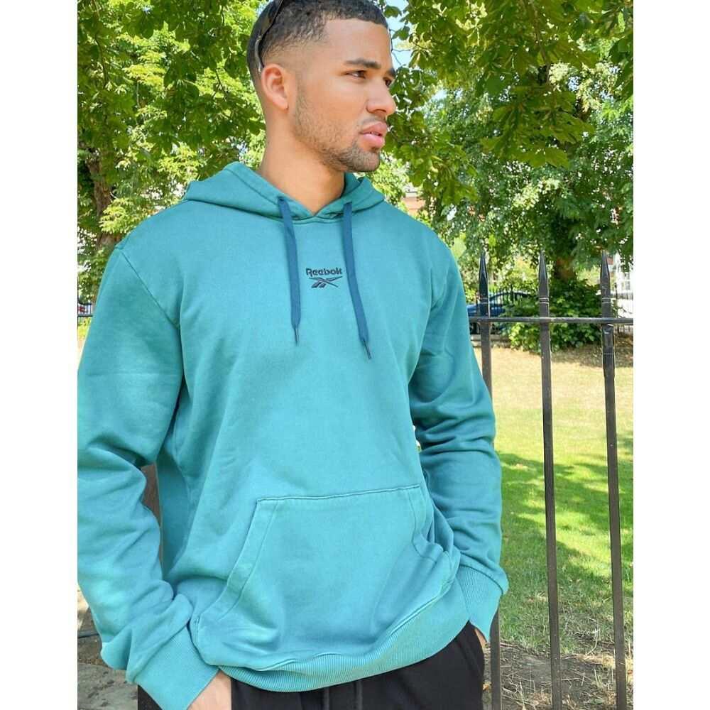 リーボック Reebok メンズ パーカー トップス【premium washed hoodie with central vector logo in blue】Blue