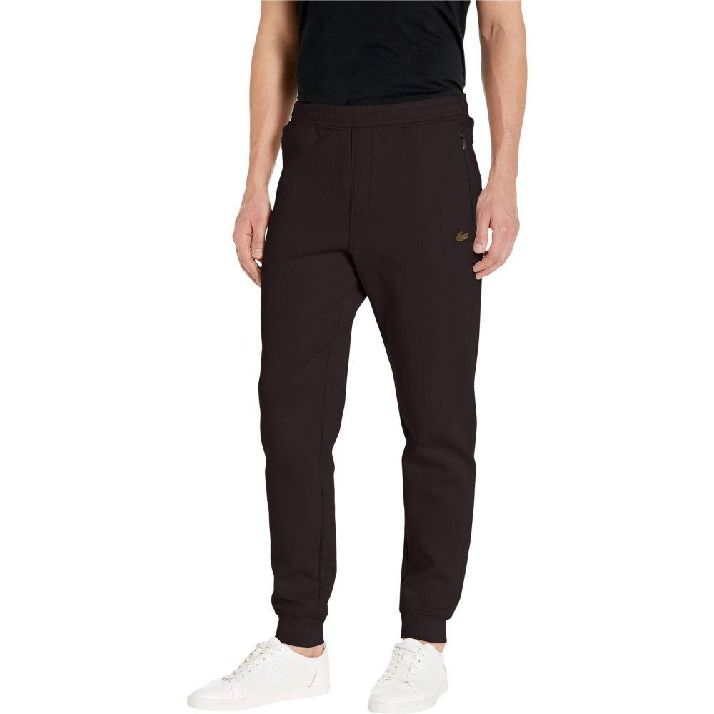 ラコステ Lacoste メンズ ボトムス・パンツ 【Solid Pant Silicon Croc Silicone Badge at Bottoms Leg 'Motion'】Black