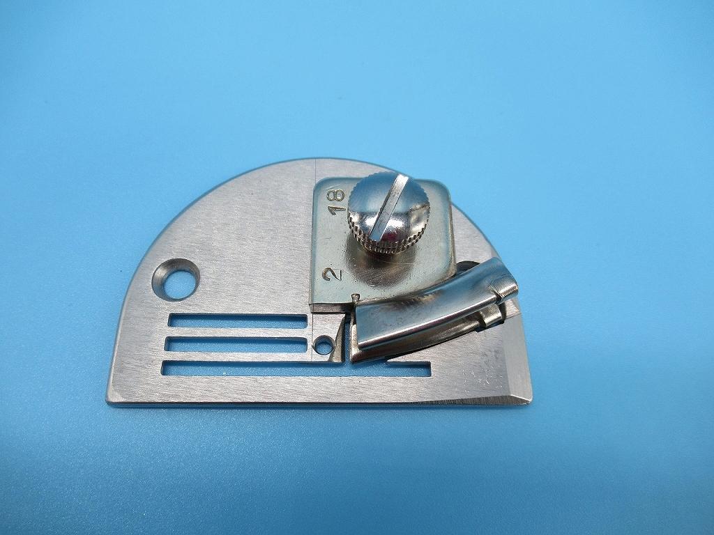 2つ折りビニールテープ用針板付きバインダー 18mm明細:ラッパ・針板・押さえ金・送り歯の4点セットです。