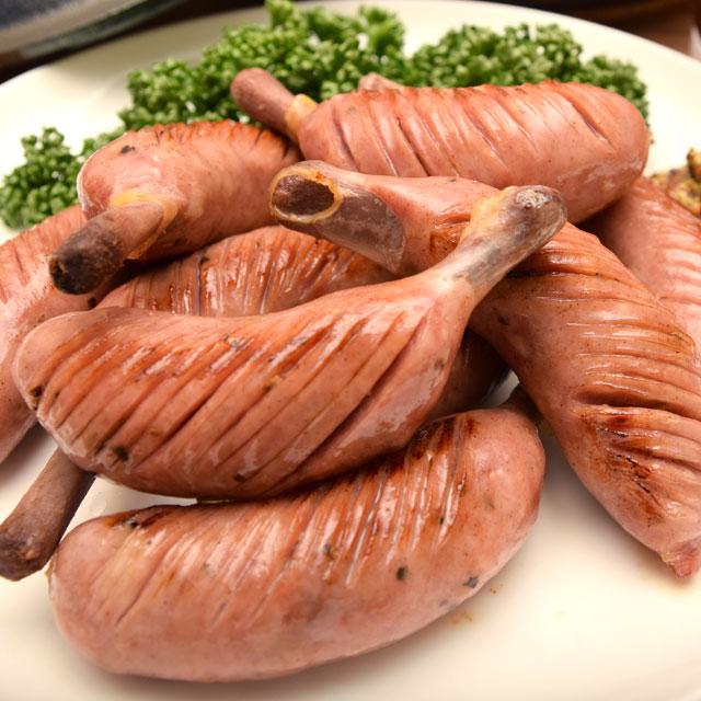 豚の粗挽き肉を天然腸詰めにした本格ソーセージ ファッション通販 食べ応えのある骨付き肉に 期間限定で特別価格 スパイスがピリッと効いているのでビールにもピッタリ 10本入 骨付きポークソーセージ