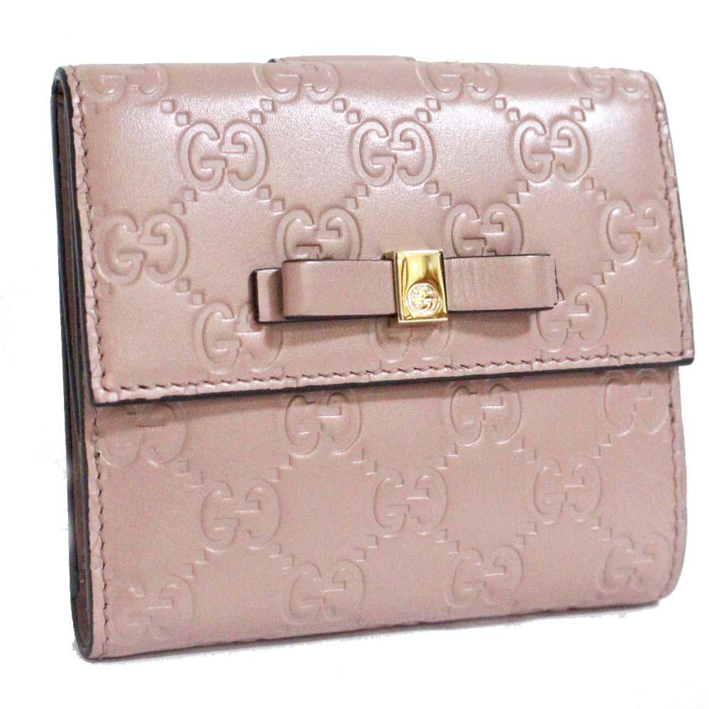 【中古】GUCCI グッチ Wホック リボン グッチシマ 二つ折り財布 レディース ピンク シマレザー 406925