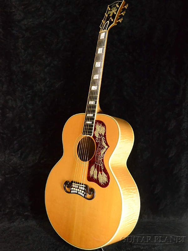 A product made in Gibson Montana Gold about 2000 [Gibson] [Montana gold] [Super Jumbo, Super Jumbo] [natural Natural,] [Acoustic Guitar, acoustic guitar, banyan tree, Folk Guitar, folk guitar]