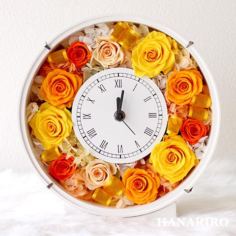 丸い時計のフレーム型の花器に黄色オレンジ系のお花をアレンジ フラワークロック 黄色オレンジ プリザーブドフラワー 花時計 時計 本日限定 壁掛け セール品 お祝い 結婚祝い 結婚記念日 出産祝い 退職祝い 送料無料 誕生日祝い 法人 花 開業祝い プレゼント ブリザードフラワ- ギフト お花 開店祝い 贈り物