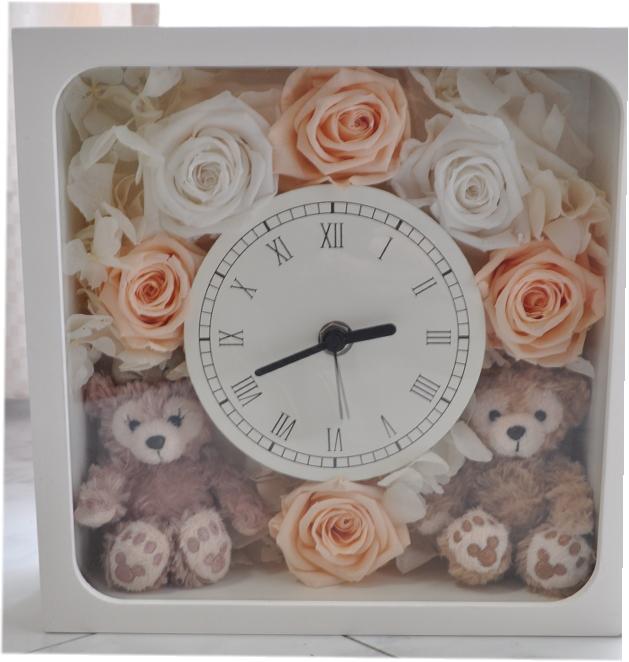 **花時計☆ホワイトデーにいかが?ディズニーシー★ダッフィー&シェリーメイがついた時計。掛け時計としても、置時計としてもつかえます。プレゼントにおすすめ!結婚祝い