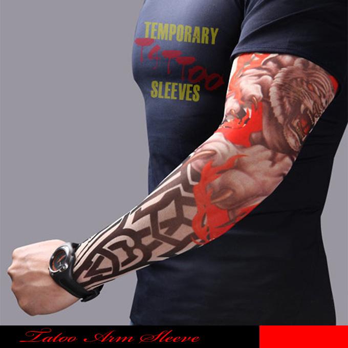 タトゥー柄がプリントされた御洒落なアームカバーです 定番キャンバス トライバルタトゥーデザインです ファイヤーとタイガーがミックスされたTATOO SLEEVE. メール便可1 時間指定不可 ☆タトゥーアームカバー タトゥーカバー タトゥースリーブ アームカバー 日焼け止めカバー タトゥーシール