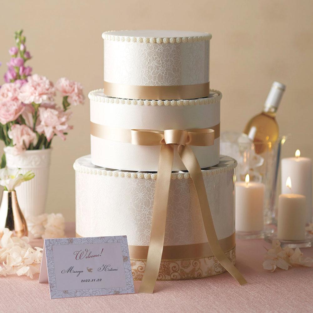 三段重ねのウェディングケーキ型プチギフトのウェエルカムボードクラシカルレセプションハートクランチチョコレート2粒入り35個セット【結婚式 ディスプレイ オブジェ シャンパンカラー】