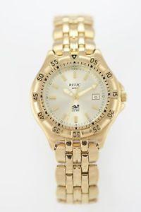 【送料無料】腕時計 ウォッチメンズステンレススチールバッテリーrelic watch mens stainless steel gold date battery water resistant 50m quartz
