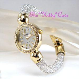 【送料無料】腕時計 ウォッチゴールドケージオーロラウォッチスワロフスキークリスタルunusual gold pltd caged aurora gems bling statement watch w swarovski crystals