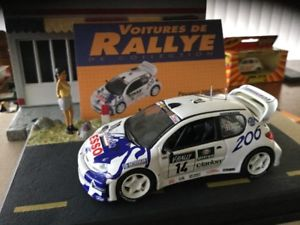【送料無料】模型車 モデルカー スポーツカープジョーラリーカーpeugeot 206 wrc rally cars 143