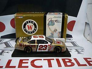 【送料無料】模型車 モデルカー スポーツカージミースペンサー#ウィンストンゴールドフォードトーラスjimmy spencer 23 winston gold 1999 ford taurus 124