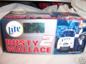 【送料無料】模型車 モデルカー スポーツカーウォーレス#ミラーライトnib rusty wallace 2 2000 taurus miller lite 164