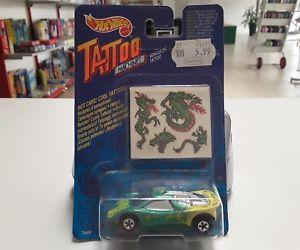 【送料無料】模型車 モデルカー スポーツカーホットホイールマシンドラゴンワゴンhot wheels tattoo machines dragon wagon in original box