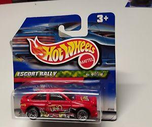 【送料無料】模型車 モデルカー スポーツカーホットフォードエスコートラリーhot wheels ford escort rally in red 4 of 4 in original box