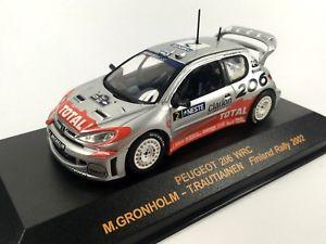 【送料無料】模型車 モデルカー スポーツカーネットワークプジョーcmグロンホルムフィンランドラリーixo altaya 143 peugeot 206 wrc m gronholm t rautiainen finland rally 2002