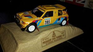 【送料無料】模型車 モデルカー スポーツカープジョーターボダカールnorev peugeot 205 turbo 16 dakar 1987 to 143