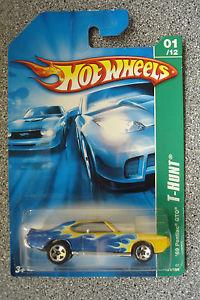 【送料無料】模型車 モデルカー スポーツカーホットホイールハントポンティアックミントhot wheels t hunt 69 pontiac gto mint and carded c2006