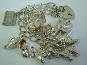 【送料無料】ブレスレット アクセサリ― ソリッドシルバーブレスレットオンスlovely solid silver charm bracelet with seven charms over one ounce