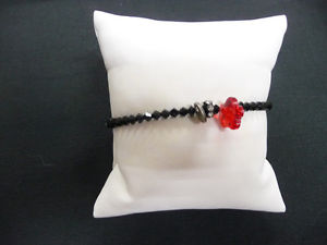 【送料無料】ブレスレット クリスタルクリスタルブレスレットbraccialetto cristallo nero con fiorellino rosso in cristallo portafortuna