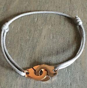 【送料無料】ブレスレット レシュルコルドングレーローズブレスレットモードles menottes sur cordon reglable gris grey en acier dor rose bracelet mode