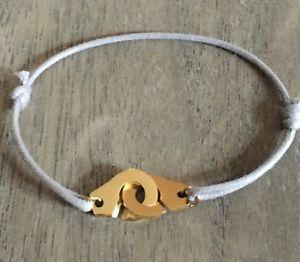 【送料無料】ブレスレット レスールコルドンコトングレーブレスレットファムファles menottes sur cordon coton reglable gris grey en acier dor bracelet femme