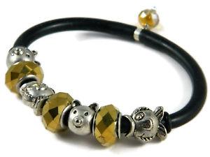 【送料無料】ブレスレット ワッシャブレスレットファッションゴムbracciale componibile moda in gomma nera elementi di ottone e rondelle dorate
