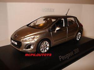 【送料無料】模型車 モデルカー スポーツカー プジョーチャコールグレーnorev peugeot 308 vapor grey 2011 au 143