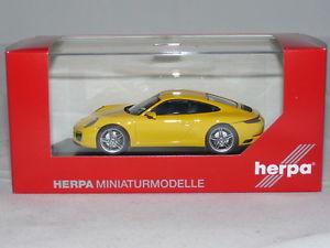 【送料無料】模型車 モデルカー スポーツカー ポルシェカレーペレーシングイエローherpa 071086 porsche 911 carrera 4 coup racing gelb 143 neu ovp