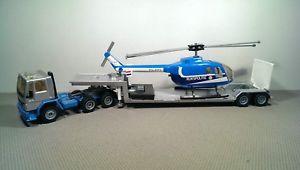 【送料無料】模型車 モデルカー スポーツカー フォードヘリコプターローダートレーラーneues angebotsiku 3719 ford cargo tieflader mit helicopter rijkspolitie sattelzug *vi5421