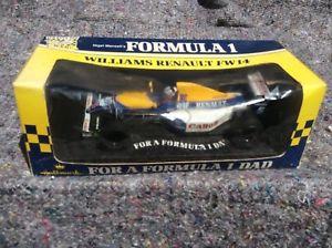 【送料無料】模型車 car モデルカー f1 スポーツカー ナイジェルマンセルウィリアムズルノーオニキスnigel mansell f1 toy williams renault fw14 car 124 scale onyx for hallmark toy, ツキダテマチ:d98ccead --- harrow-unison.org.uk