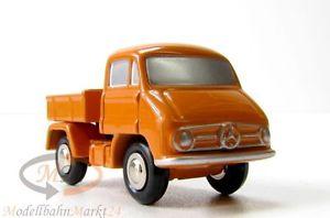 【送料無料】模型車 モデルカー スポーツカー schuco 566501 piccolo mb unimog 411 lkw mit pritsche in orange mastab 190