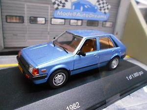 【送料無料】模型車 モデルカー スポーツカー マツダハッチバックドアハッチバックネットワークホワイトボックス