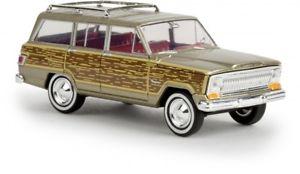 【送料無料】模型車 モデルカー スポーツカー ジープゴールド187 brekina jeep wagoneer woody gold 19856